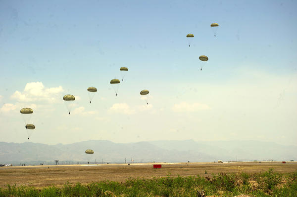 "Honduran paratroopers with U.S. Special Forces soldiers during a ""static line jump"" (UNASOC News Service / Creative Commons)"