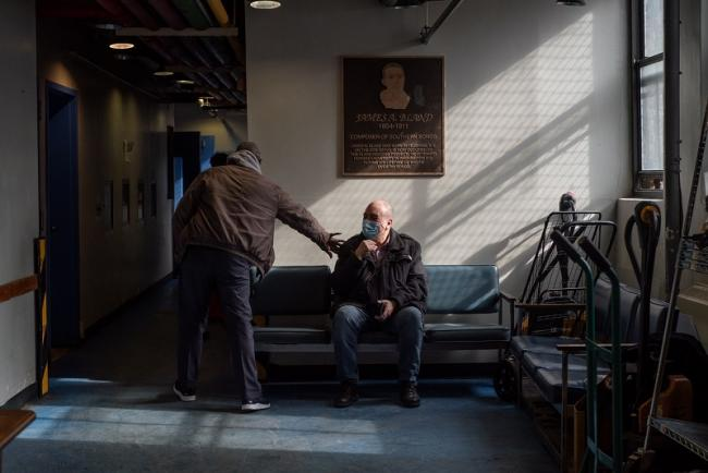 Pedro Rodríguez is greeted by one of his colleagues at La Jornada. Rodríguez, who has worked in food banks for more than a decade, opened the doors of La Jornada the same day that New York implemented quarantine measures. (Ximena Natera)