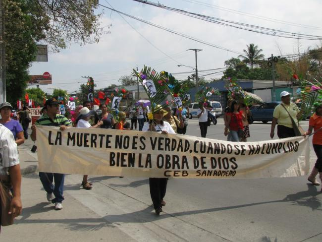 """The CEB San Romero marches with a banner reading: """"Death is not true when the work of God has been well fulfilled,"""" a play on a quote by Cuban poet and freedom fighter José Martí. (Laurel Marshall Potter)"""