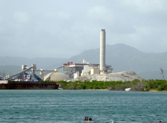 People swim near the AES coal plant in Guayama, Puerto Rico. (Hilda Lloréns)