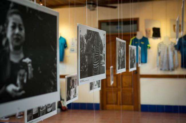 Photographs hang from the main hall of the Instituto de Historia de Nicaragua y Centroamérica. In each, family members hold images or photos of their deceased loved one. (Photo courtesy of Museo de la Memoria Contra la Impunidad)
