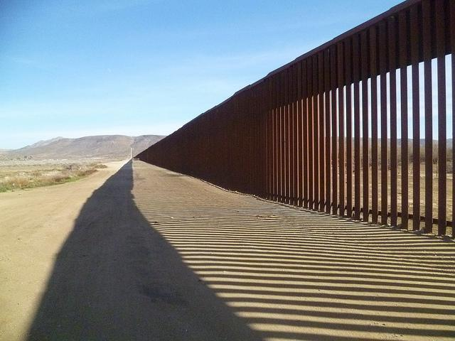 A segment of U.S. border fencing in the desert near San Diego and Tijuana  (Living-Learning Programs / Creative Commons)