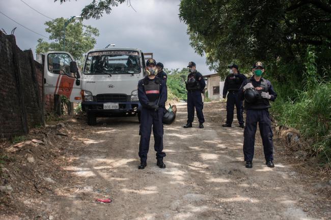 Security personnel guard the entrance to the Pascuales cemetery, on the northern periphery of Guayaquil in April. (Comité Permanente por la Defensa de los Derechos Humanos)
