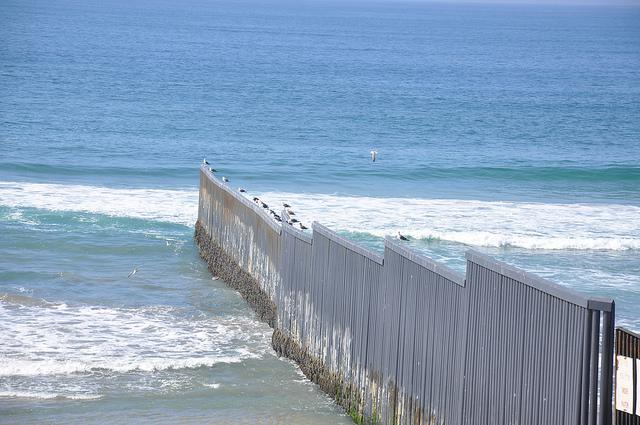 Along the U.S.-Mexico border, fencing stretches into the Pacific (BBC World Service / Creative Commons)