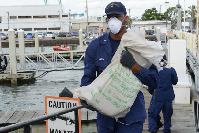 The Coast Guard offloads an estimated $1.9 million of marijuana contraband in Miami, Florida (Coast Guard News / Creative Commons)