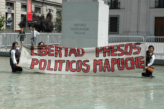 Mapuche activists demonstrate in a fountain during a hunger strike. (Flickr/the future is unwritten)