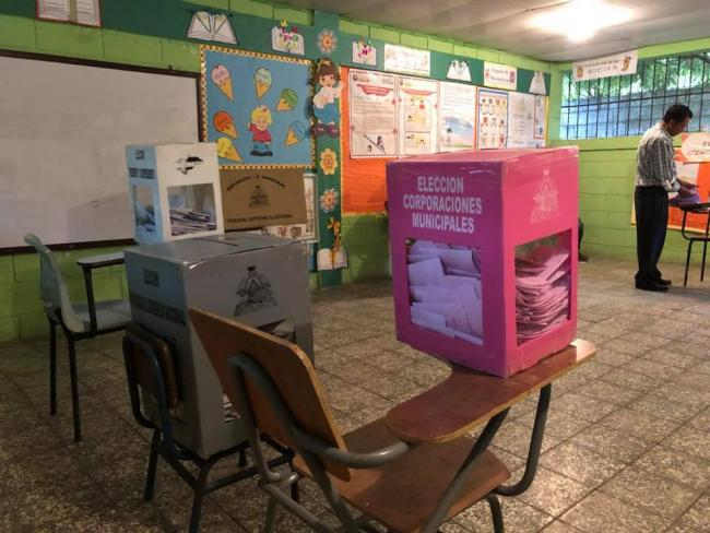 Ballot boxes in a Honduran school. (Photo by Suyapa Portillo).