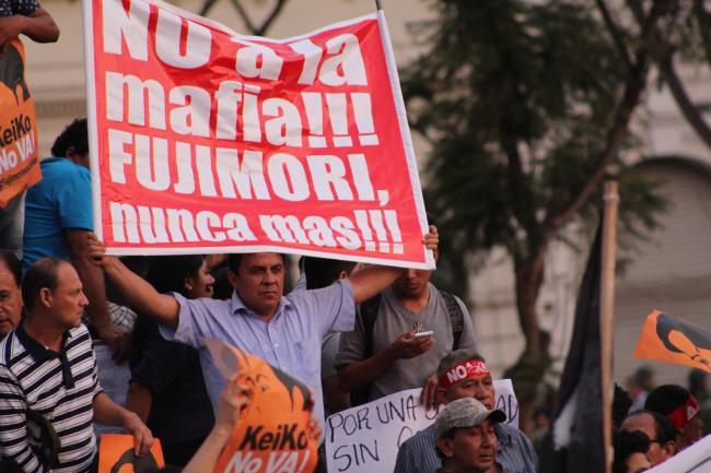 "2016 demonstration commemorating the April 5, 1992 Peruvian constitutional crisis under Alberto Fujimori, often described as an ""autogolpe de estado."" (ClavarClavitos/Flickr)"