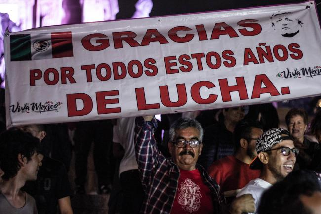 "An AMLO supporter's sign reads ""Thank you for all these years of struggle"" (Efra Tzuc/Flickr)"