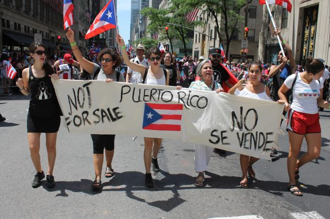 """Puerto Rico is Not for Sale,\"" a banner at this year's Puerto Rican Day Parade reads (Joe Catron/Flickr)"