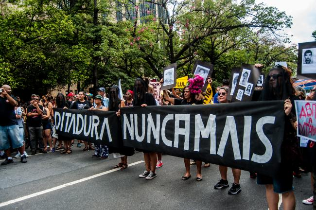 Protesters in Belo Horizonte, Brazil, commemorate victims of the dictatorship in response to President Jair Bolsonaro's suggestion that the coup be celebrated. (Midia Ninja/Flickr)