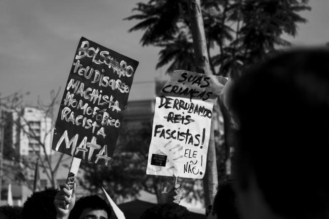 """Bolsonaro, your machista, homophobic, racist discourse kills,"" reads a sign protesting Jair Bolsonaro, currently leading the polls in Brazil's upcoming presidential elections (Fabio Montarroios/Flickr)"