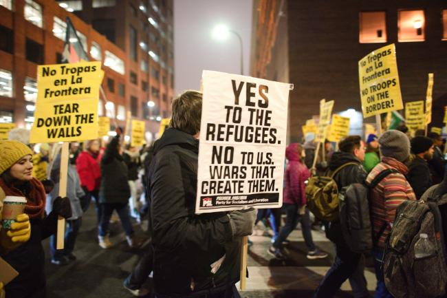 A march in support of refugees in Minneapolis, Minnesota, last November (Fibonacci Blue/Flickr)