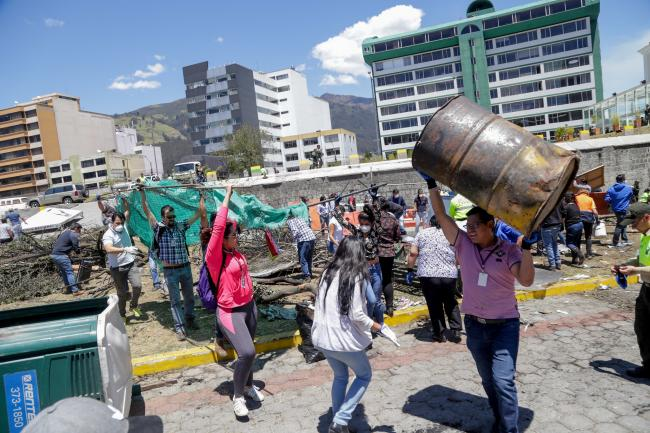 Public workers clean up debris after the protests ended with a deal between Indigenous leaders and the government. (Photo by Asamblea Nacional del Ecuador / Flickr)