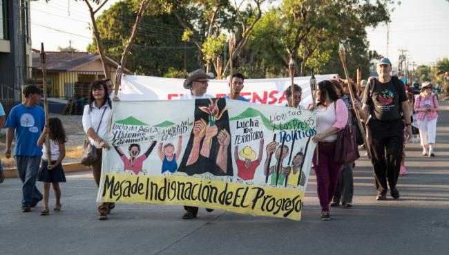 Activists in the Bajo Aguán region of Honduras demonstrated in support of their right to health, land, and water in March 2019. (Peg Hunter, Flickr)