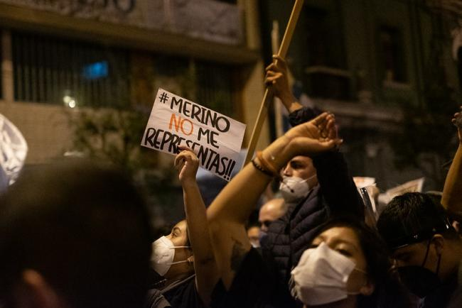 "A protester holds a sign reading ""Merino, you do not represent me,"" in Lima, November 12, 2020. (Samatha Hare / Flickr)"