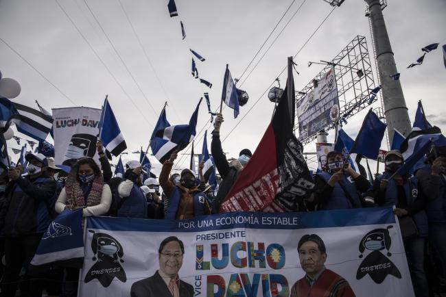 Attendees wave flags and hold signs during a campaign rally for presidential candidate for the Movement for Socialism party (MAS) Luis Arce in La Paz, Bolivia, on Wednesday, Oct. 14, 2020. (Marcelo Pérez Del Carpio)