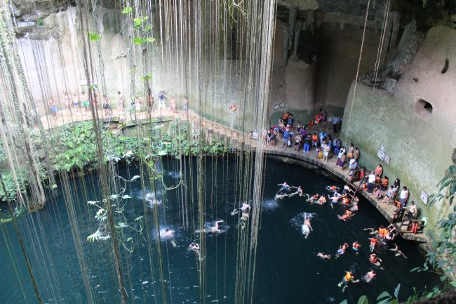 Cenotes are sacred sites for the Maya but many, like this one at Ik Kil, have become tourist sites. (Shinya Suzuki, Flickr)