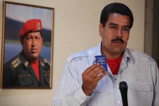 Five days after former President Hugo Chávez's death, President Nicolás Maduro makes a statement to the press on March 10, 2013 in front of Chávez's portrait. (Prensa Miraflores, Hugo Chávez, Flickr)