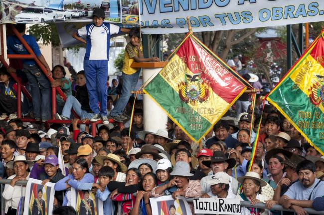Supporters listen to Evo Morales speak in Cliza, Bolivia on July 6, 2013. (Photo by Dominic Chavez/World Bank via Flickr)