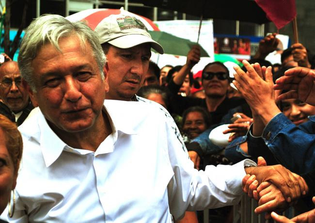 "Andres Manuel Lopez Obrador, president of the National Council of Movimiento de Regeneración Nacional (National Regeneration Movement), at the end of the ""March-rally in defense of oil"" in the Columbus Monument in Mexico City."