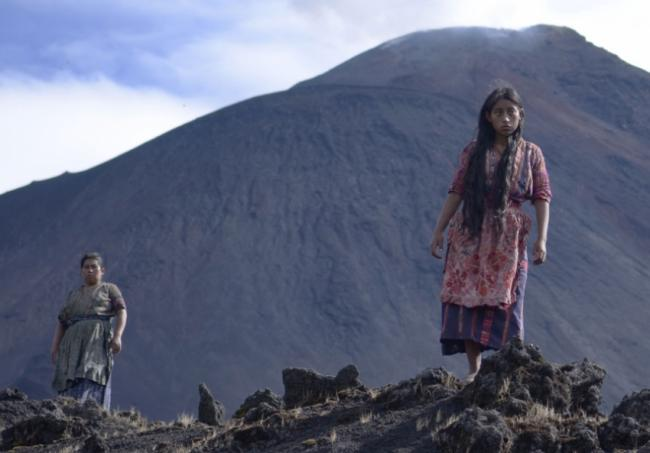 Maria (María Mercedes Coroy) jumps over rocks in an attempt to induce an abortion, gazing out at the world beyond the volcano. (Photo by Julie Romano)