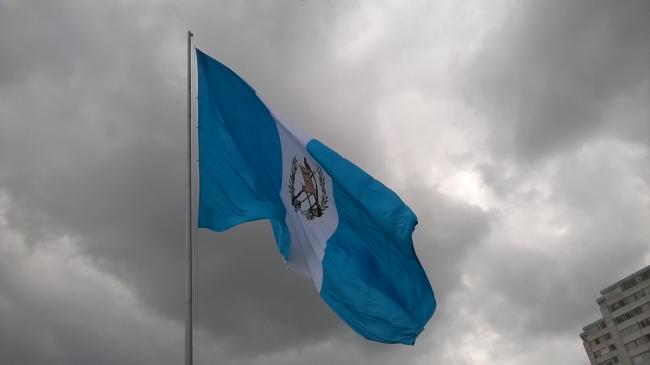 Guatemalan flag near the famous Palacio Nacional on Independence Day. (Pablo Vásquez/Wikipedia Commons)