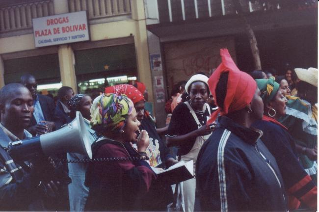 A protest by Afro-Colombian communities in Bogotá demanding the resumption of peace talks in 2002. (Jared Goyette / Creative Commons)
