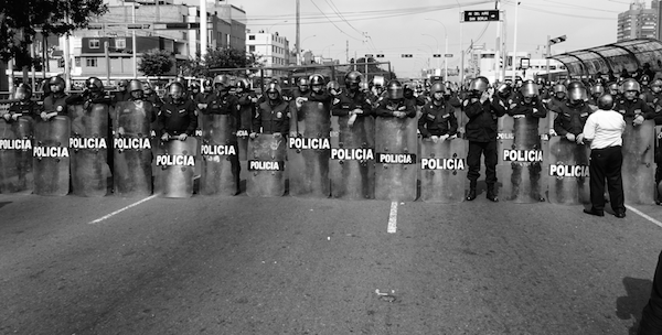 Police line up during a massive protest against the extractive economic model in Lima, 2015 (Photo by Michael Wilson Becerril)