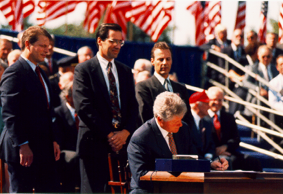 Bill Clinton signing NAFTA into law in late 1993 (Wikimedia Commons)