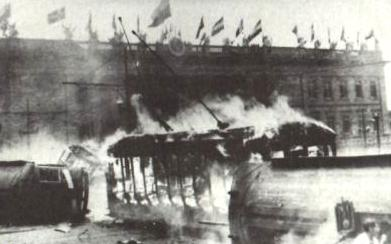 A train car on fire in Bogotá during the Bogotazo revolt after the assassination of Jorge Eliécer Gaitán (Wikimedia Commons)