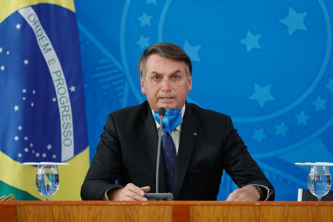 Brazilian president Jair Bolsonaro in a press conference with the Ministry of Health on March 20 (Photo courtesy Palácio do Planalto/Flickr)