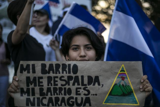 """My neighborhood backs me...my neighborhood is Nicaragua."" Student protester at an SOS Nicaragua protest against Daniel Ortega in Managua in May 2018 (Flickr/Jorge Mejía Peralta)."