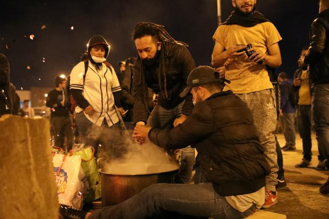 Volunteers offer free coffee at the protest site Portal Resistencia in Bogotá. (Christina Noriega)