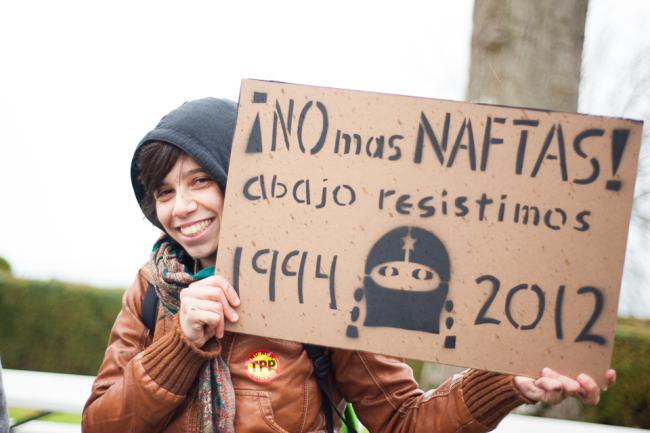 """A sign at an anti-TPP protest reads, """"No more NAFTAS! We resist from below."""" (Caelie Frampton)"""