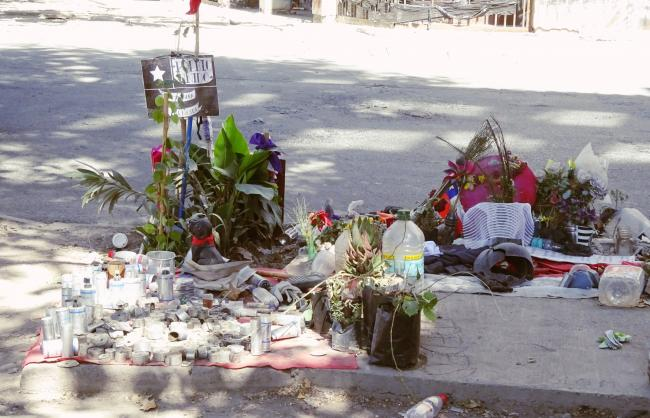 Memorial to Mauricio Fredes, who died trying to escape from the Carabineros in December. Note the spent Carabinero bullets and canisters piled at the left. (Photo by J. Patrice McSherry)