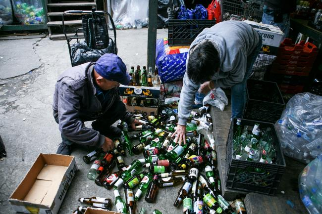 Elderly canners sorting bottles for redemption at Sure We Can (Photo by Carlos Rivera)
