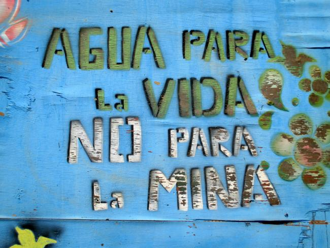 'Water For Life, Not For The Mine' reads a sign at La Puya, where locals have maintained a roadside protest camp for five years as part of a strategy to block mining operations in Guatemala. (Photo by Sandra Cuffe)