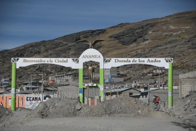 "The sign on the entrance to Ananea, a squatter city that houses workers in a region filled with informal mines, reads, ""Welcome to the Golden City of the Andes."" (Heather Williams)"