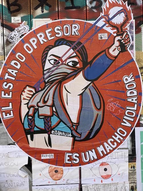 "Street art by Marcela Paz Peña (Isonauta), reading ""THE OPPRESSIVE STATE IS A MACHO RAPIST,"" city center, Santiago. (Terri Gordon-Zolov)"