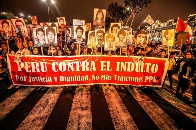 Peruvians took to the streets on December 28, days after President Pedro Pablo Kuczynski (PPK) announced a humanitarian pardon for Alberto Fujimori, convicted of grave violations of human rights - Peru Against the Pardon, for Justice, Dignity, No More Betrayals PPK - the sign reads (Photo by Walter Hupiu Tapia)