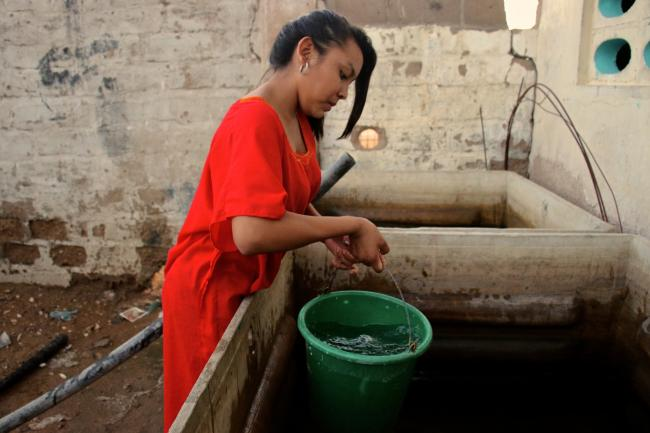 A boarding school student retrieves clean water to bathe in the Wayuu hamlet of Ipapure. (Photo by Christina Noriega)