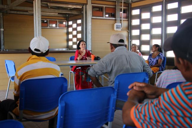 Ana Iguarán meets with Ipapure community leaders to discuss EPM's proposal to build a wind farm on their land. (Photo by Christina Noriega)
