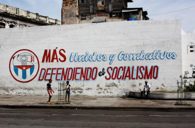 """More united and combative, defending socialism,"" reads a wall in Havana, Cuba, painted with the logo of the Committees for the Defense of the Revolution. (Photo by Marcel601/Flickr)"