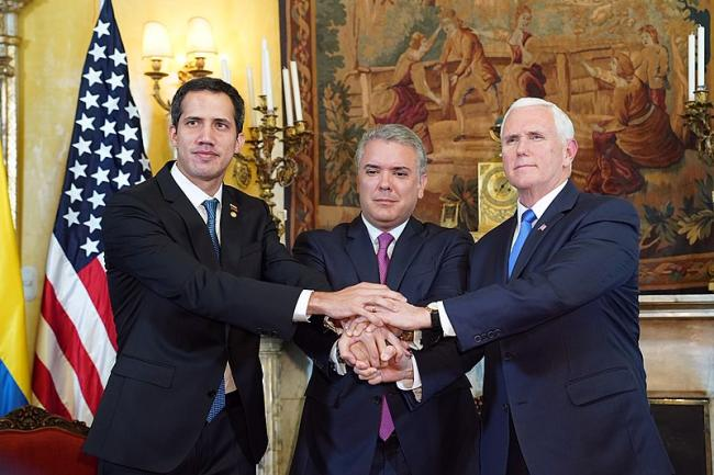 "Vice President Mike Pence, ""interim president"" Juan Guaidó, and President Iván Duque (Photo by D. Myles Cullen/Wikimedia)"