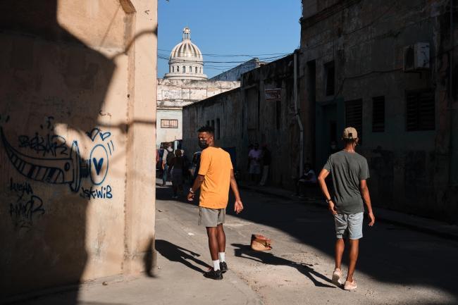 Two boys walk on the street near the Capitolio in Central Havana. (Natalia Favre)