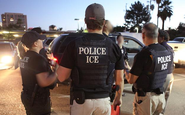 ICE officers arrest undocumented immigrants during a wave of deportations in 2011. (U.S. Immigration and Customs Enforcement)
