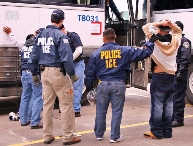 ICE Special Agents (U.S. Immigration and Customs Enforcement) arresting suspects during a raid. (Photo courtesy of ICE/Wikimedia)