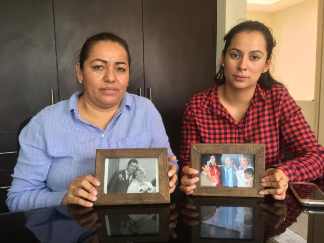 Left, Frida Urtiz Martínez (wife of Salvador Adame Pardo) and right, Navidad Adame Urtiz (daughter) with photos of missing journalist Salvador Adame Pardo of Nueva Italia, Michoacán. (Photograph by Patrick Timmons)