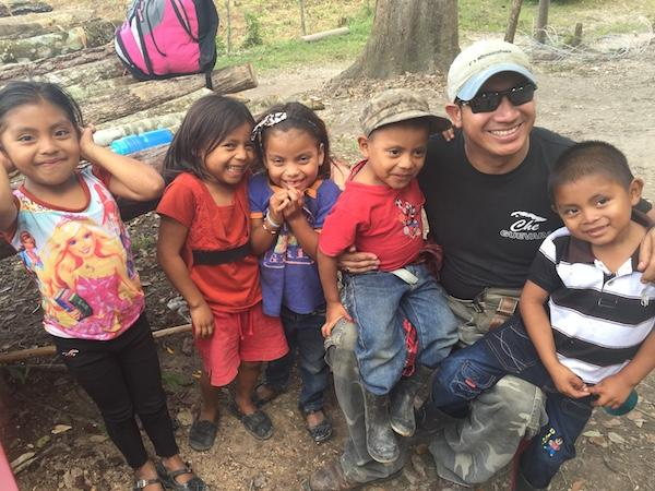 Edwin Espinal, posing in November 2015 with young friends in Rio Blanco, where he had gone to support Berta Cáceres, just months before her assassination. (Photo by Karen Spring.)